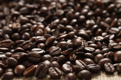 Coffee beans on cloth sack Stock Photo