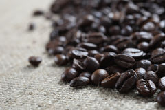 Coffee beans on cloth sack Royalty Free Stock Photo