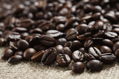 Coffee beans on cloth sack Stock Photography