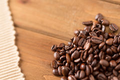Coffee Beans and Cloth on Wood Royalty Free Stock Images