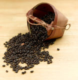 Coffee beans  and coconut leaf basket Royalty Free Stock Photos