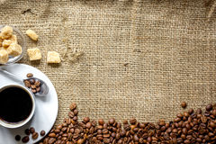 Coffee beans, coffe cup on linen cloth background top view Royalty Free Stock Image