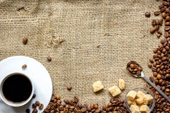 Coffee beans, coffe cup on linen cloth background top view Stock Photography