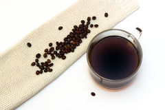 Coffee beans and coffe cup  on white background. With pullover Royalty Free Stock Images