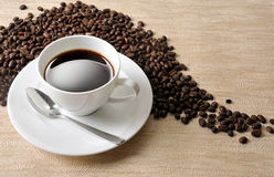 Coffee  beans. Coffee Background. A cup of coffee and beans Background Stock Photos