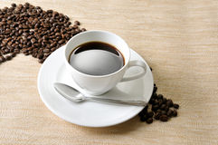Coffee  beans. Coffee Background. A cup of coffee and beans Background Stock Photo