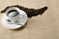 Coffee  beans.Coffee Background. A cup of coffee and beans Background Stock Photo