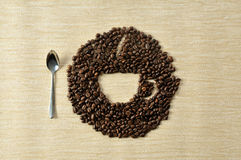 Coffee  beans.Coffee Background. A cup of coffee and beans Background Royalty Free Stock Photo