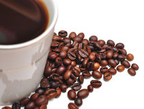 Coffee beans in coffee cup Stock Photography