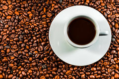 Coffee beans and coffee cup.  Stock Photography