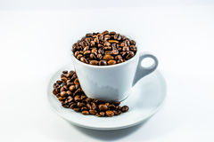 Coffee beans and coffee cup.  Royalty Free Stock Images