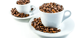 Coffee beans and coffee cup.  Royalty Free Stock Photo