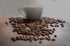 Coffee Beans And Coffee Cup Stock Images