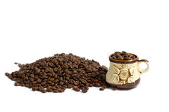 Coffee Beans and a Coffee cup with Beans Inside Stock Image