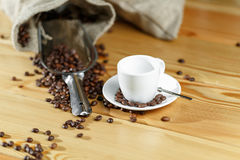 Coffee beans and coffee cup. Espresso. on a wooden table Royalty Free Stock Images