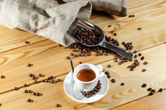 Coffee beans and coffee cup. Espresso. on a wooden table Royalty Free Stock Image