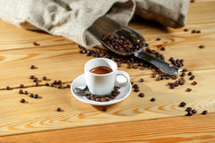 Coffee beans and coffee cup. Espresso. on a wooden table Stock Photos