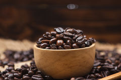 Coffee beans. Coffee cup full of coffee beans. Coffee beans. Coffee cup full of coffee beans Stock Photos