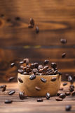 Coffee beans. Coffee cup full of coffee beans. stock images