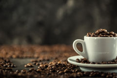 Coffee beans. Coffee cup full of coffee beans. Toned image.  Stock Photo