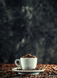 Coffee beans. Coffee cup full of coffee beans. Toned image.  Stock Photos