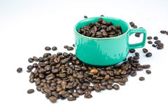 Coffee beans in coffee cup. Coffee beans in green coffee cup Royalty Free Stock Photography