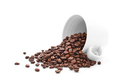 Coffee beans in coffee cup isolated on white Stock Photos
