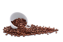 Coffee beans in coffee cup isolated on white Stock Photography
