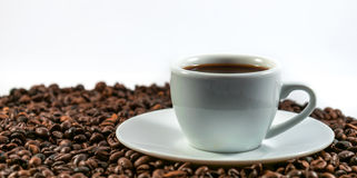 Coffee beans and coffee cup. Isolated on a white background Royalty Free Stock Photo