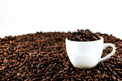 Coffee beans and coffee cup. Isolated on a white background Stock Images