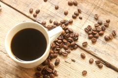 Coffee beans and coffee cup for mornings wake up Stock Photography