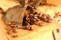 Coffee beans and coffee cup for mornings wake up Stock Images