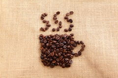 Coffee beans with coffee cup shape Royalty Free Stock Photography