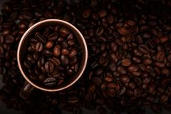View from the top - coffee. Coffee beans in a coffee cup viewed from the top Stock Photography
