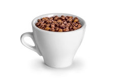 Coffee beans in coffee cup. On white Royalty Free Stock Photo