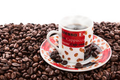 Coffee beans and coffee cup. White background Royalty Free Stock Photography