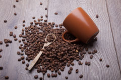 Coffee beans and coffee cup on wooden surface stock images