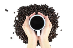 Coffee beans and Coffee drink hand. Coffee beans and Coffee drink on hand royalty free stock images