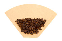 Coffee beans on a coffee filter Stock Photography