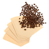 Coffee beans on a coffee filter Royalty Free Stock Photo