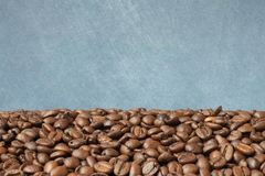 Coffee beans. Coffee grains located on a beautiful background royalty free stock images