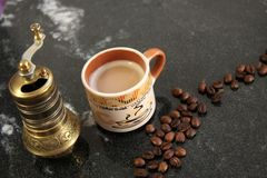 Coffee beans and coffee grinder, antique Royalty Free Stock Photography