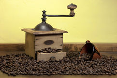 Coffee beans, coffee grinder and cup Royalty Free Stock Photography