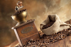Coffee beans and coffee grinder Stock Photos