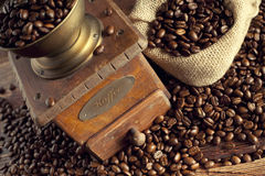 Coffee beans and coffee grinder Stock Images