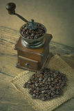 Coffee beans and Coffee grinder on the wood Stock Photo