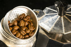 Coffee beans on a coffee maker Royalty Free Stock Image