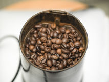 Coffee Beans In Coffee Maker. Macro shot of coffee beans in a coffee maker, shallow depth of field Stock Photography