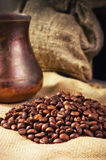 Coffee beans, coffee maker on sacking in vintage grunge style Royalty Free Stock Images