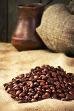 Coffee beans, coffee maker on sacking in vintage grunge style Stock Image